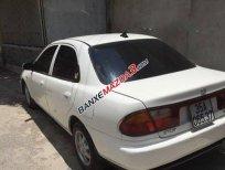 Chính chủ cần bán Mazda 323 MT 2000, màu trắng số sàn