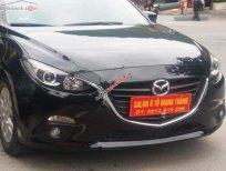 Cần bán Mazda 3 1.5 AT năm 2015, màu đen số tự động