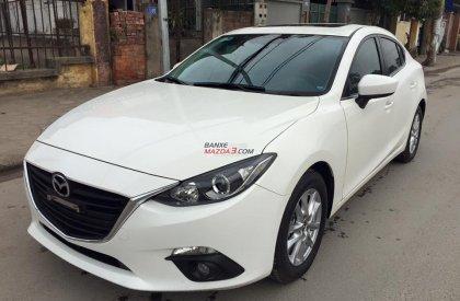 Cần bán xe ô tô Mazda 3 1-5-AT-Sedan đời 2015, màu trắng, 700 triệu