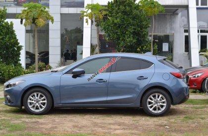 Bán xe Mazda 3 1.5 Hatchback màu xám xanh giá 730 triệu.